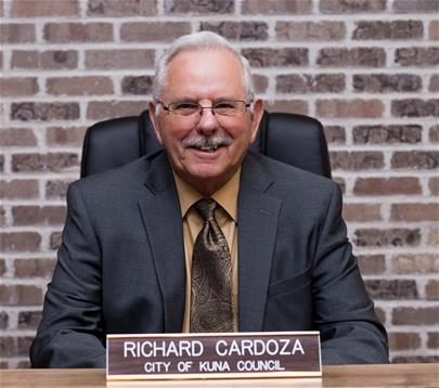 Richard Cardoza sitting behind nameplate in council chambers